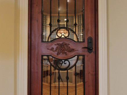 Square top door with radius glass, wrought iron and hand carving