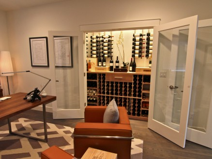 Wine alcove adjacent to an office